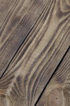 Achtergrond van geweven planken van licht hout diagonaal gerangschikt