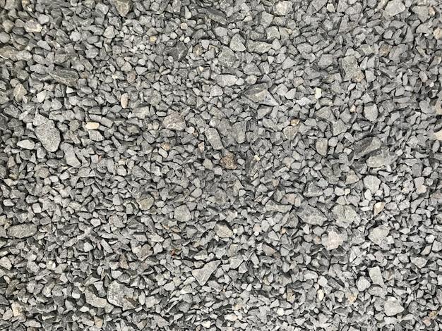 Achtergrond van grijze grind kiezelsteen kleine stenen textuur