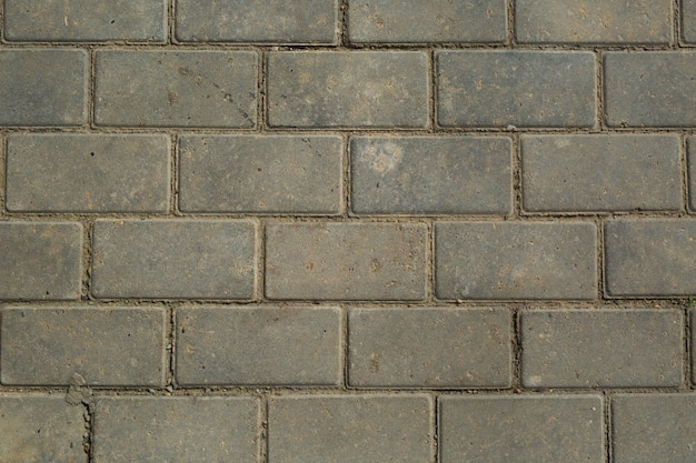 Achtergrond van grijze muur gemaakt van bakstenen