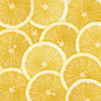 Achtergrond van heap verse gele citroenplakken