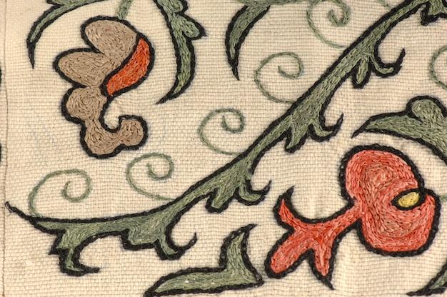Achtergrond van het weefsel en textiel met oosterse sierlijke ornament en patroon