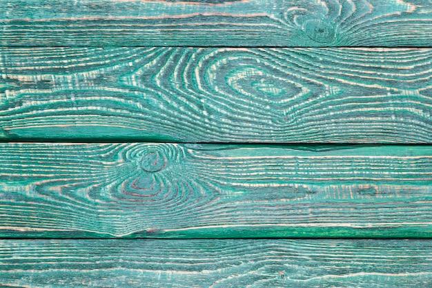 Achtergrond van houten textuurraad met de rest oude groene verf.