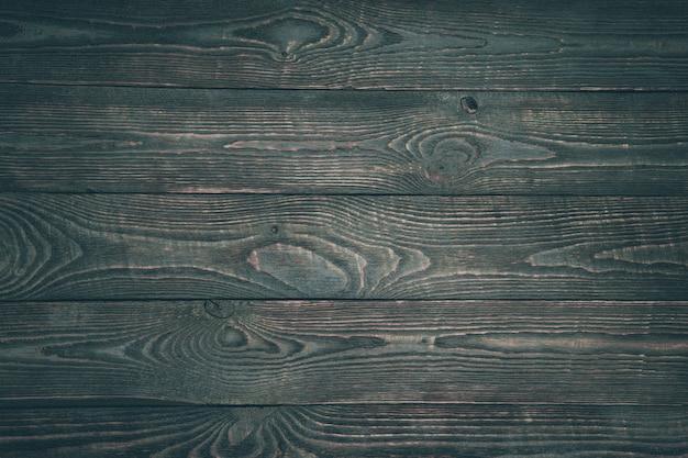 Achtergrond van houten textuurraad met resten van donkere verf.