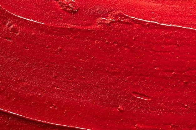 Achtergrond van lippenstift uitstrijkje penseelstreken, kopie ruimte