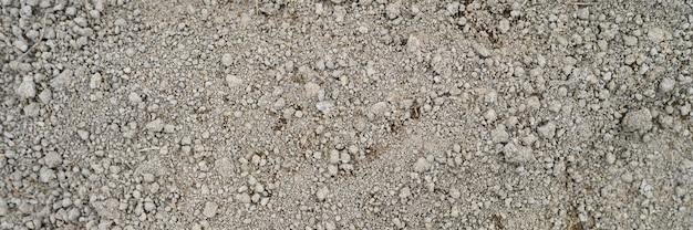 Achtergrond van losgemaakte gedroogde aarde grond textuur met niets op, klaar voor opplant.