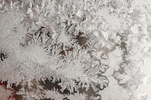 Achtergrond van natuurlijk bevroren glas, vensterglas met een mooi patroon