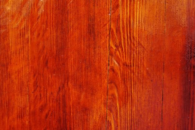 Achtergrond van natuurlijke geknoopte houtstructuur, hout gekleurd en gepolijst