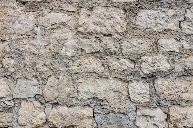 Achtergrond van natuurlijke oude steenbaksteen van een oud kasteel, haag.