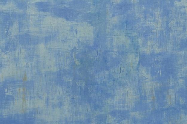 Achtergrond van oud geschilderd plaatstaal met roest in blauw geschilderd.