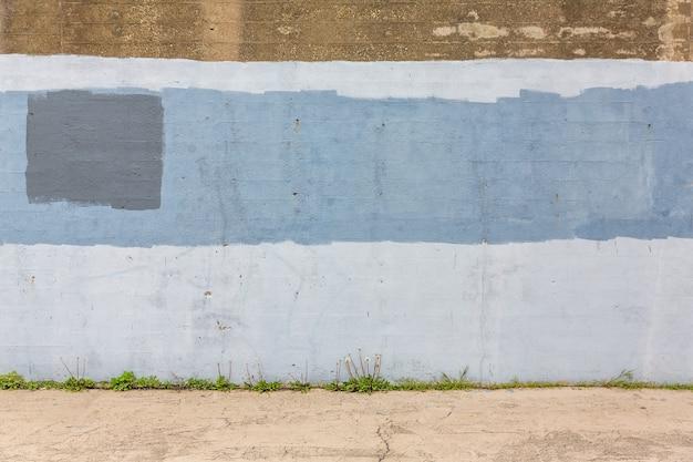 Achtergrond van oude grijs geschilderde muur. leeftijd straat muur achtergrond, textuur.
