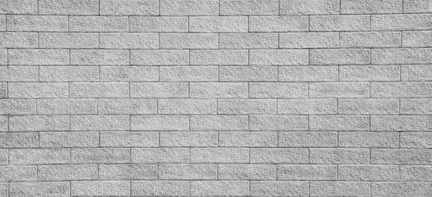 Achtergrond van oude uitstekende zwart-wit bakstenen muur