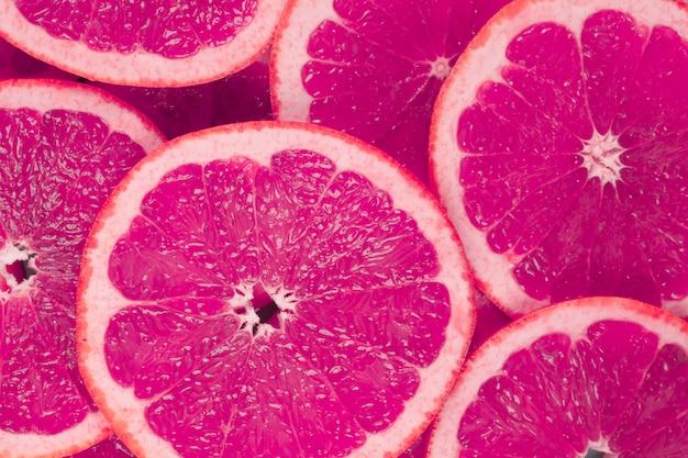 Achtergrond van sappige grapefruits plakjes