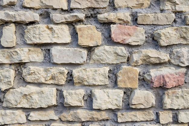 Achtergrond van stenen muur textuur. oude muur gebouwd van witte steen. natuurlijke stenen. muur geweven