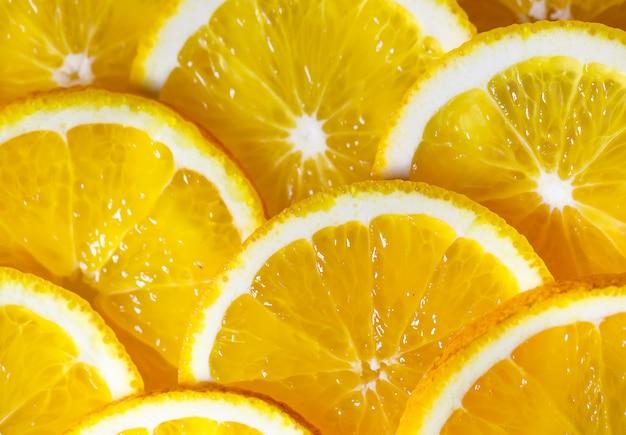 Achtergrond van stukjes sinaasappel.