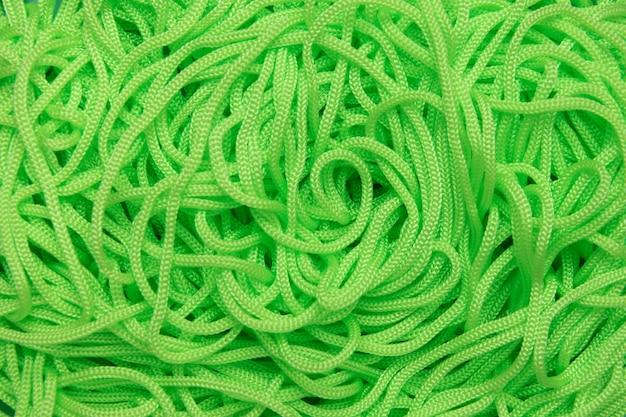 Achtergrond van textielkoorden van heldergroene kleur.