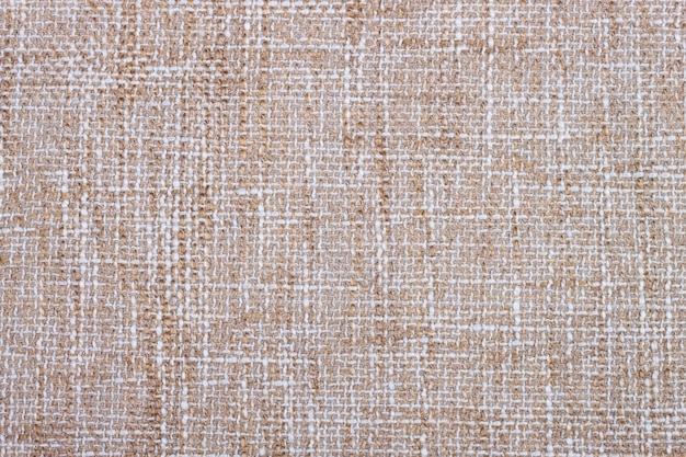 Achtergrond van textieltextuur. beige geweven stoffenclose-up