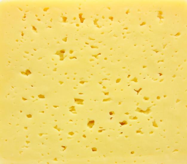 Achtergrond van verse gele zwitserse kaas met gaten