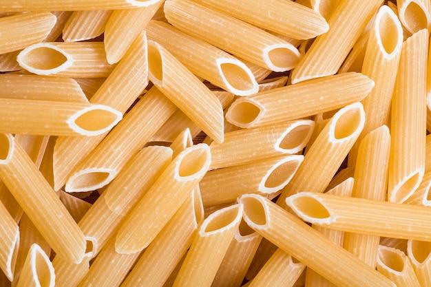 Achtergrond van verspreide cilindrische pasta