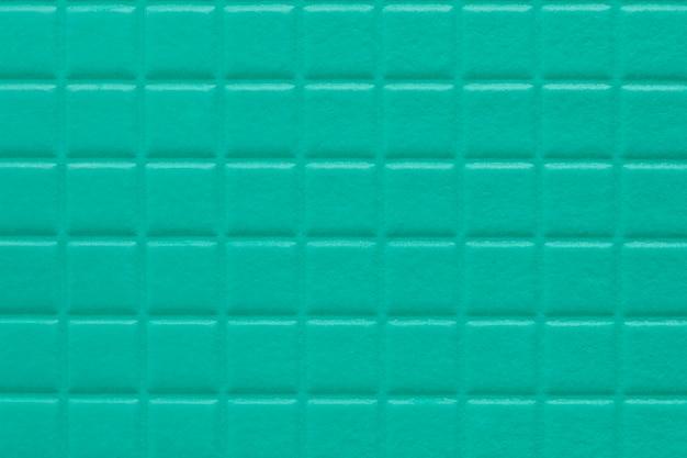 Achtergrond van vierkanten met een zachte textuur van turkooise kleur