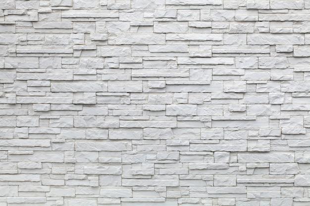 Achtergrond van witte stenen, decoratief muuroppervlak