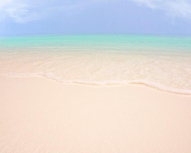 Achtergrond van zeezand en hemel