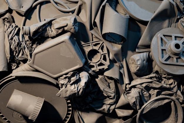 Achtergrond van zwart plastic afval dat moet worden gerecycled