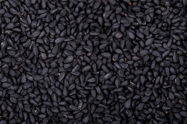 Achtergrond van zwarte zaden bovenaanzicht