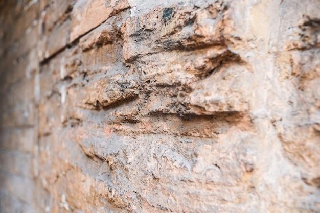 Achtergrond voor ontwerpers antieke bakstenen textuur. bakstenen muur textuur bij daglicht. veel stenen. Premium Foto
