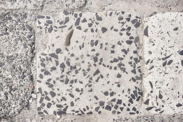 Achtergrond wegtextuur. harde oude geschilderde grijze muur in grungestijl. close-up weergave