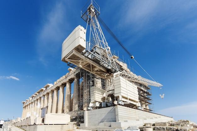 Achtergrondafbeelding van wederopbouw van het parthenon in de akropolis, athene, griekenland