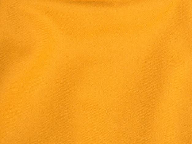 Achtergronden en texturen. oranje katoenen stoffenclose-up