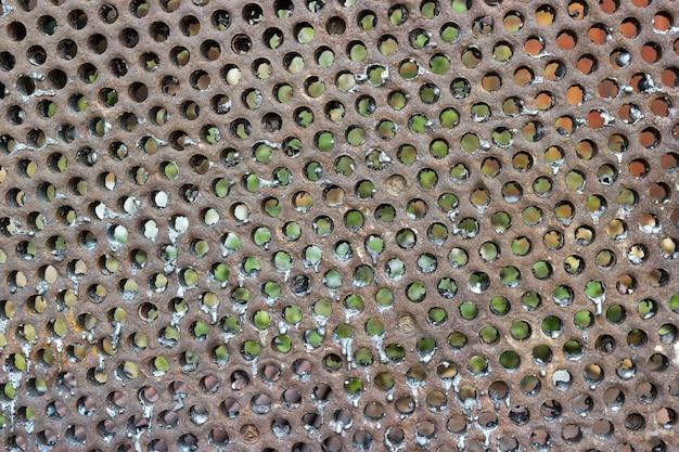 Achtergrondencollectie - textuur van roestige geperforeerde metalen achtergrond