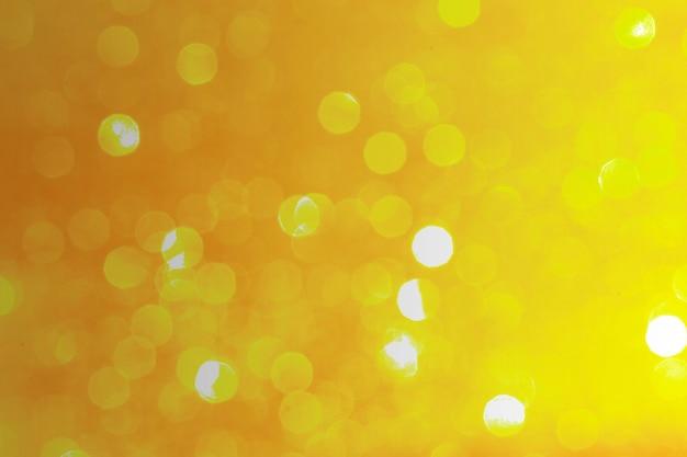 Achtergrondontwerp met gouden bokeh-patroon