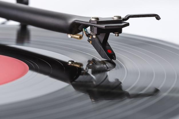 Achtergrondpatroon voor vinylplaten. tonorms met opneemkop. kopieer ruimte. detailopname.