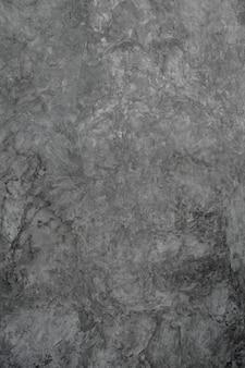 Achtergrondpleister ruw grijs cementmortier