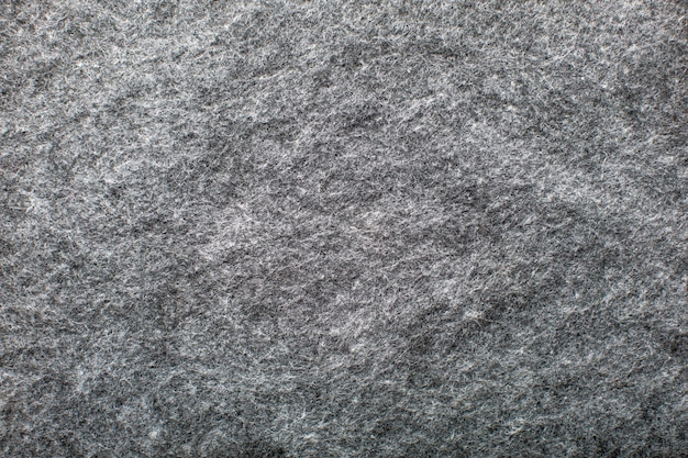 Achtergrondstructuur van grijze wollen stof