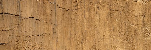 Achtergrondstructuur van het gladde oppervlak van het zand. bovenaanzicht. banner