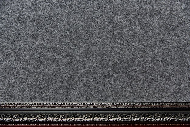 Achtergrondtextuur van de dutte stof met een decoratief kader.