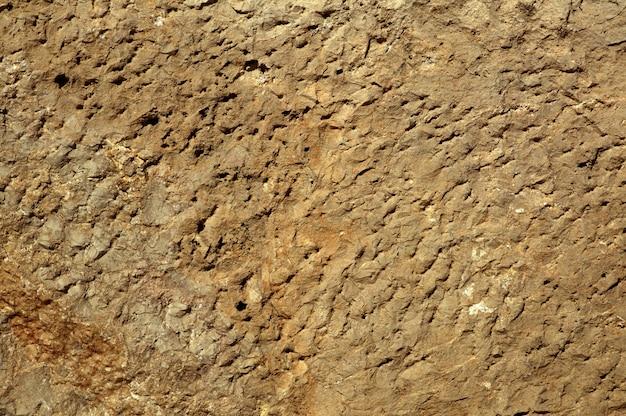 Achtergrondtextuur van de oppervlakte van de kalksteensteen