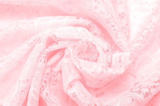 Achtergrondtextuur van gevoelige kantstof van roze kleuren dichte omhooggaand. zachte focus.