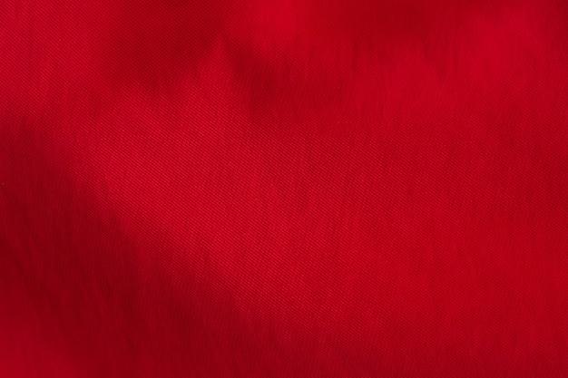 Achtergrondtextuur van golvend rood cutton.