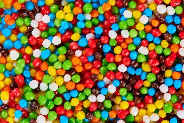 Achtergrondtextuur van helder kleurrijk snoepjesclose-up.