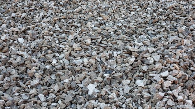 Achtergrondtextuur van kleine stenen van de zeekust