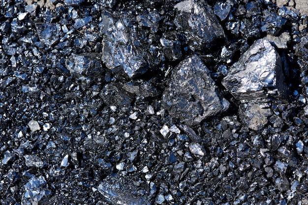 Achtergrondtextuur van stukken van steenkoolclose-up.