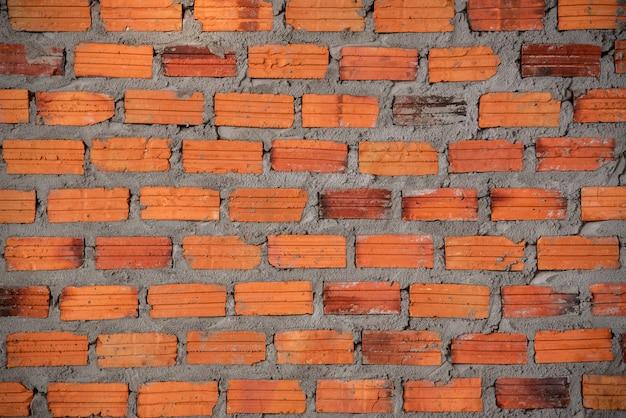 Afbeeldingen van bakstenen of kleibakstenen gemaakt van oranje kleimaterialen voor het creëren van een achtergrondafbeelding, geschikt voor inscripties op graffiti.