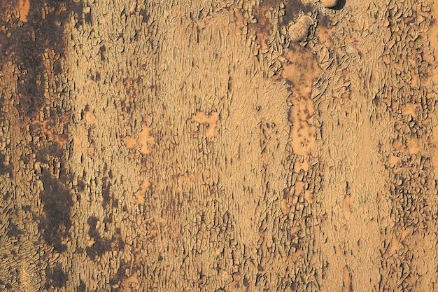 Afbladderende verf roestende metalen ruwe textuur. achtergrond van afbladderende verf en roestig oud metaal