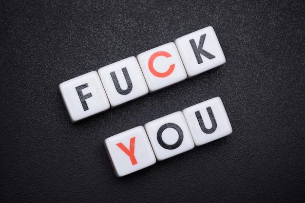 Alfabet letter dobbelstenen tekst spelling fuck you