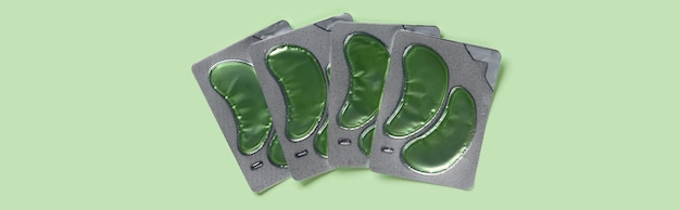 Aloë vera kruideningrediënten ooglapjes over groene achtergrondkleur