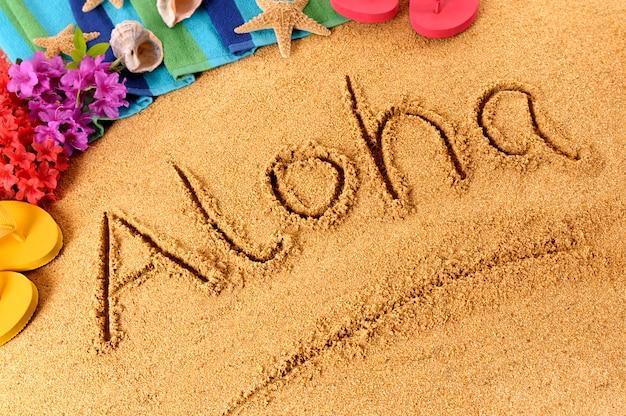 Aloha geschreven in het zand
