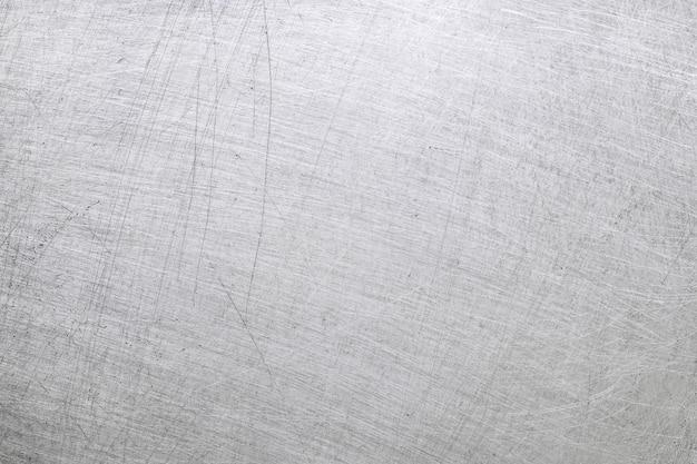 Aluminium metalen textuur achtergrond met krassen en gepolijst.